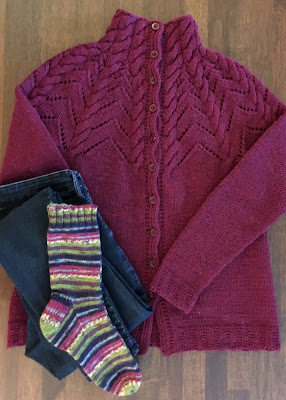 Hand-knitted socks color matched to cardigan and jeans