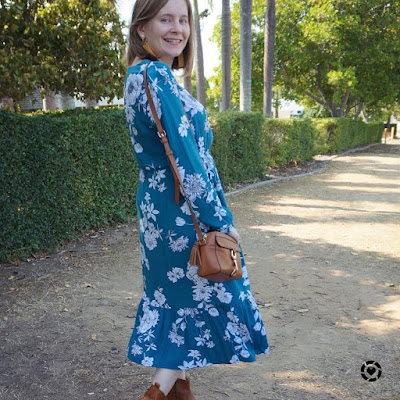 awayfromtheblue Instagram | Kmart teal floral midi dress with tan accessories spring church outfit