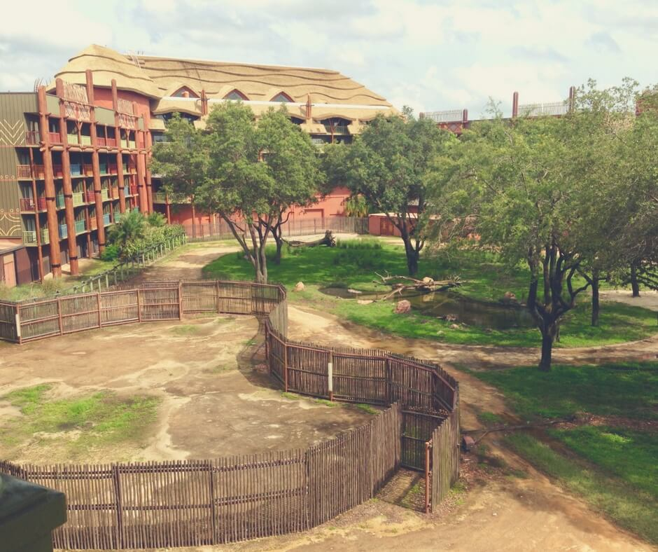 A photo taken from a viewing point in Animal Kingdom Lodge showing part of the hotel and inside the Savannah.