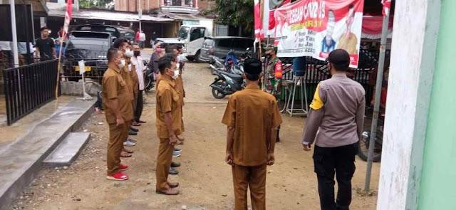 Tingkatkan Kedisiplinan Perangkat Desa, Babinsa Koramil 12/Sry Pimpin Apel Pagi