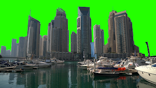 The city of dubai as seen from the marina with skyline set against a green screen background.