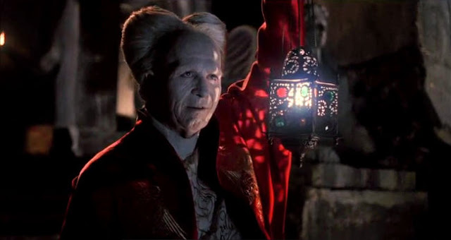 Gary Oldman in red robe and ageing make-up as Dracula