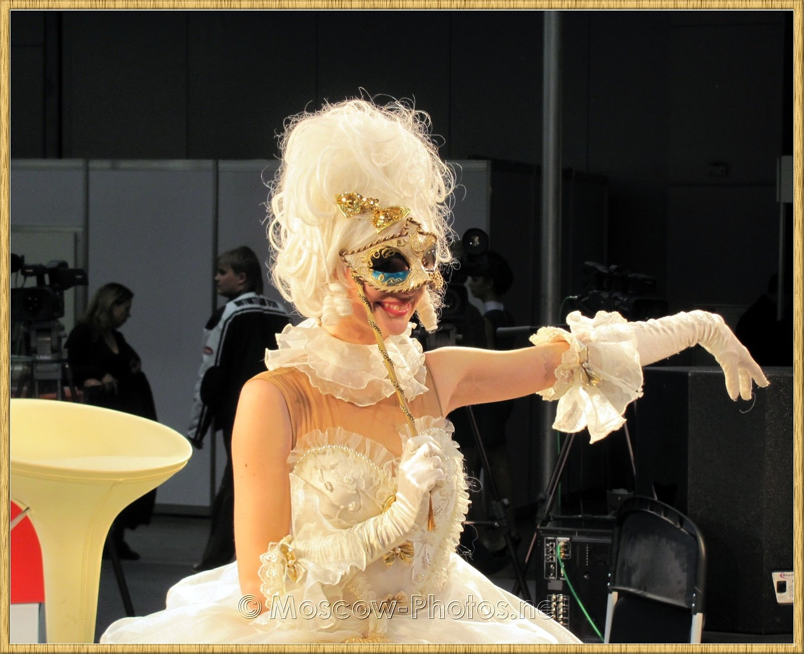 A girl in white ball gown and mask at  Photoforum - 2010