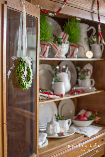 little boxwood wreath on glass door