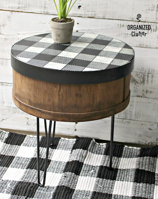 Photo of a cheese box repurposed as a side table