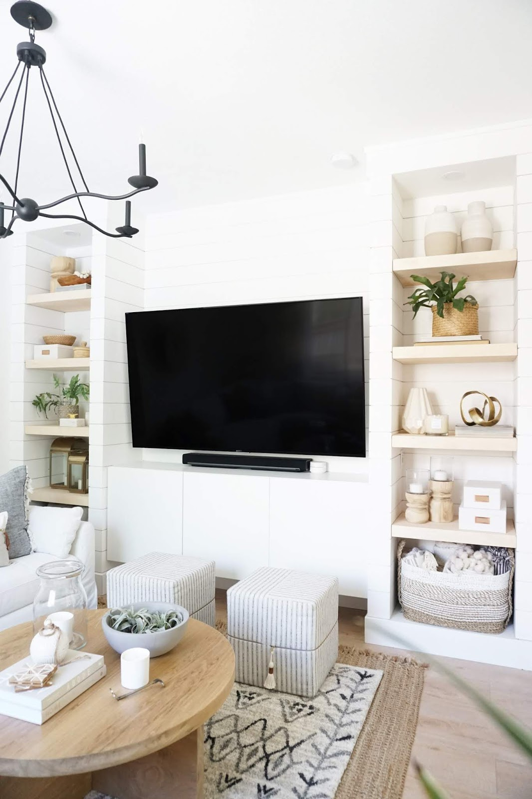 Built-in TV wall unit with shelves and flap