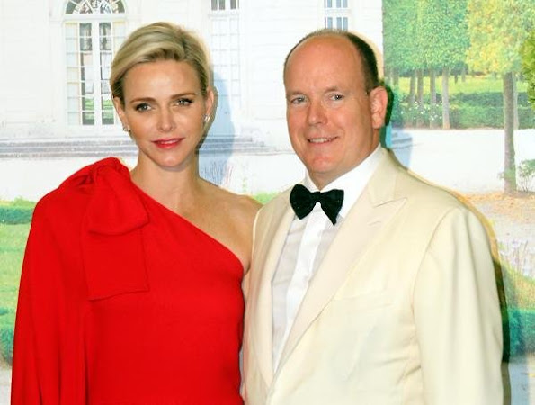 Princess Charlene of Monaco wore Valentino One Shoulder Jumpsuit in Red.