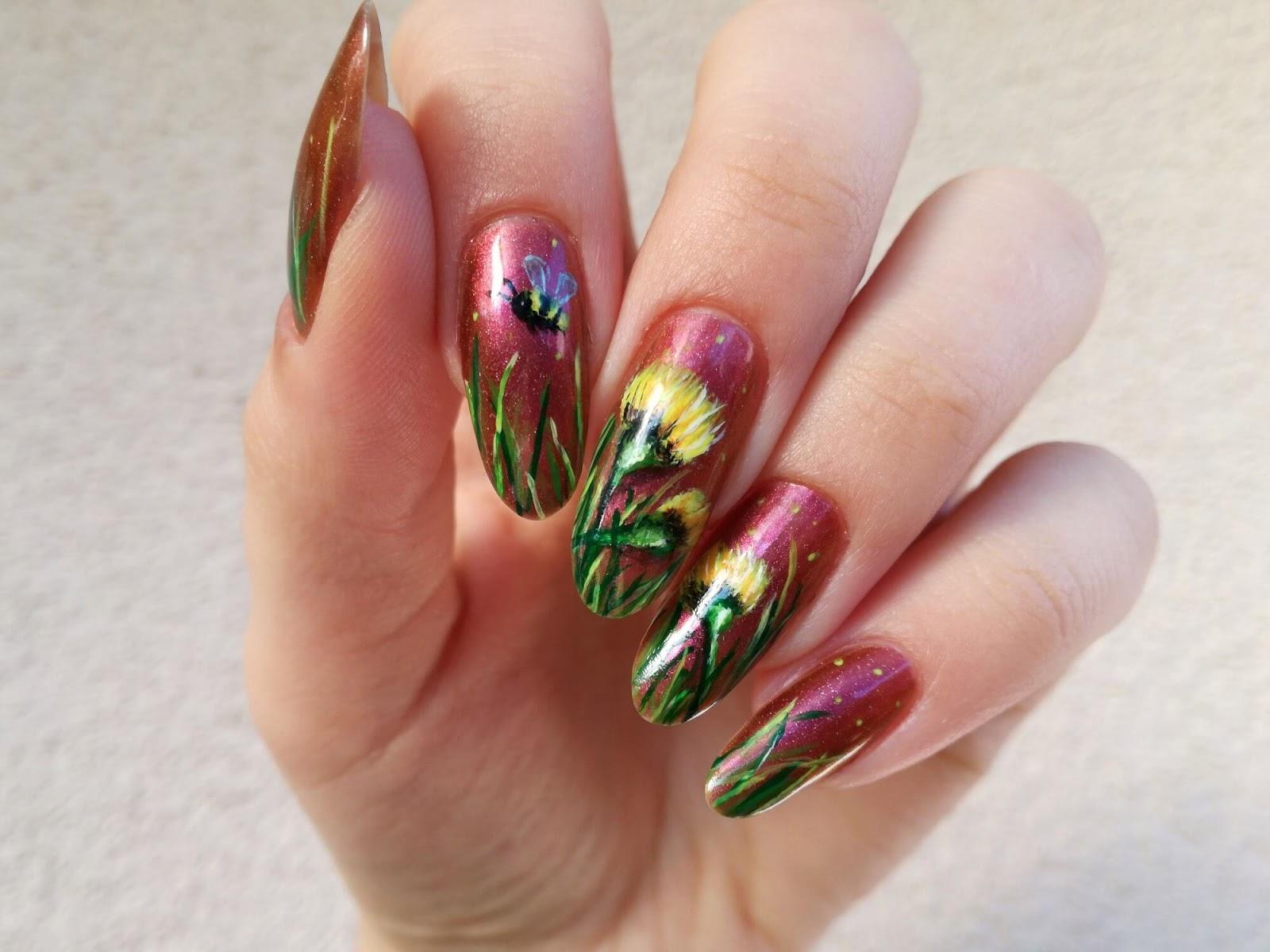 Malowane żółte kwiaty na paznokciach