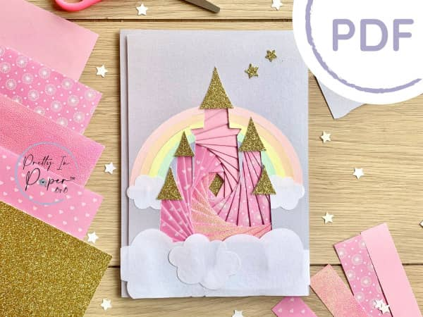 iris folded castle greeting card on table surrounded by paper crafting supplies