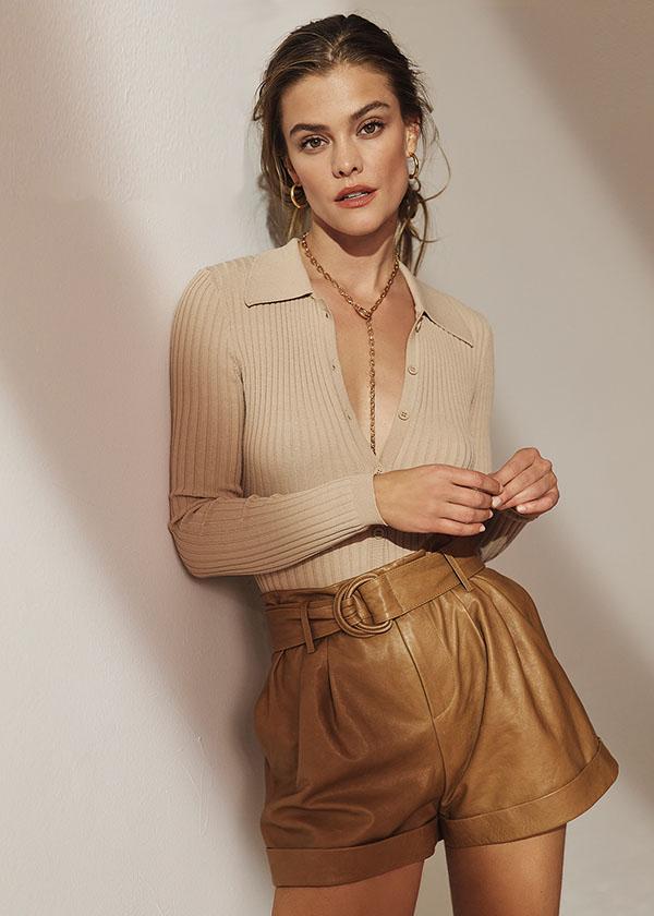 Wearing Nina top and Frame shorts