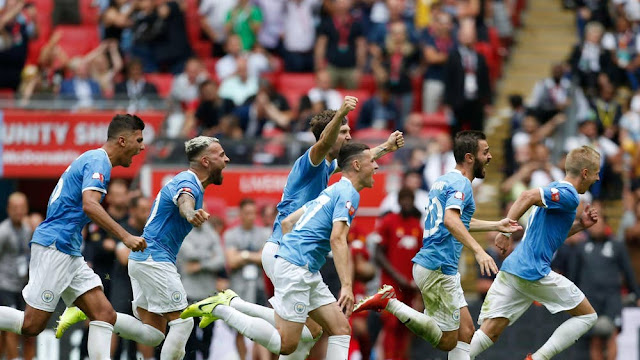 Man city players celebrate 2019 community shield win over Liverpool