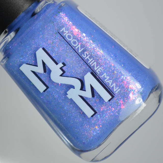 periwinkle nail polish with shimmer and flakies in a bottle