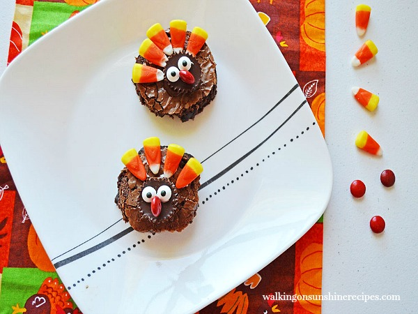 Turkey Brownies on White Plate with candy corn from Walking on Sunshine Recipes