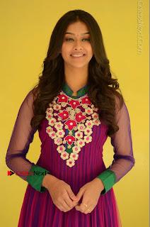 Actress Pooja Jhaveri Latest Stills in Purple Salwar Kameezt at Dwaraka Success Meet  0101.JPG
