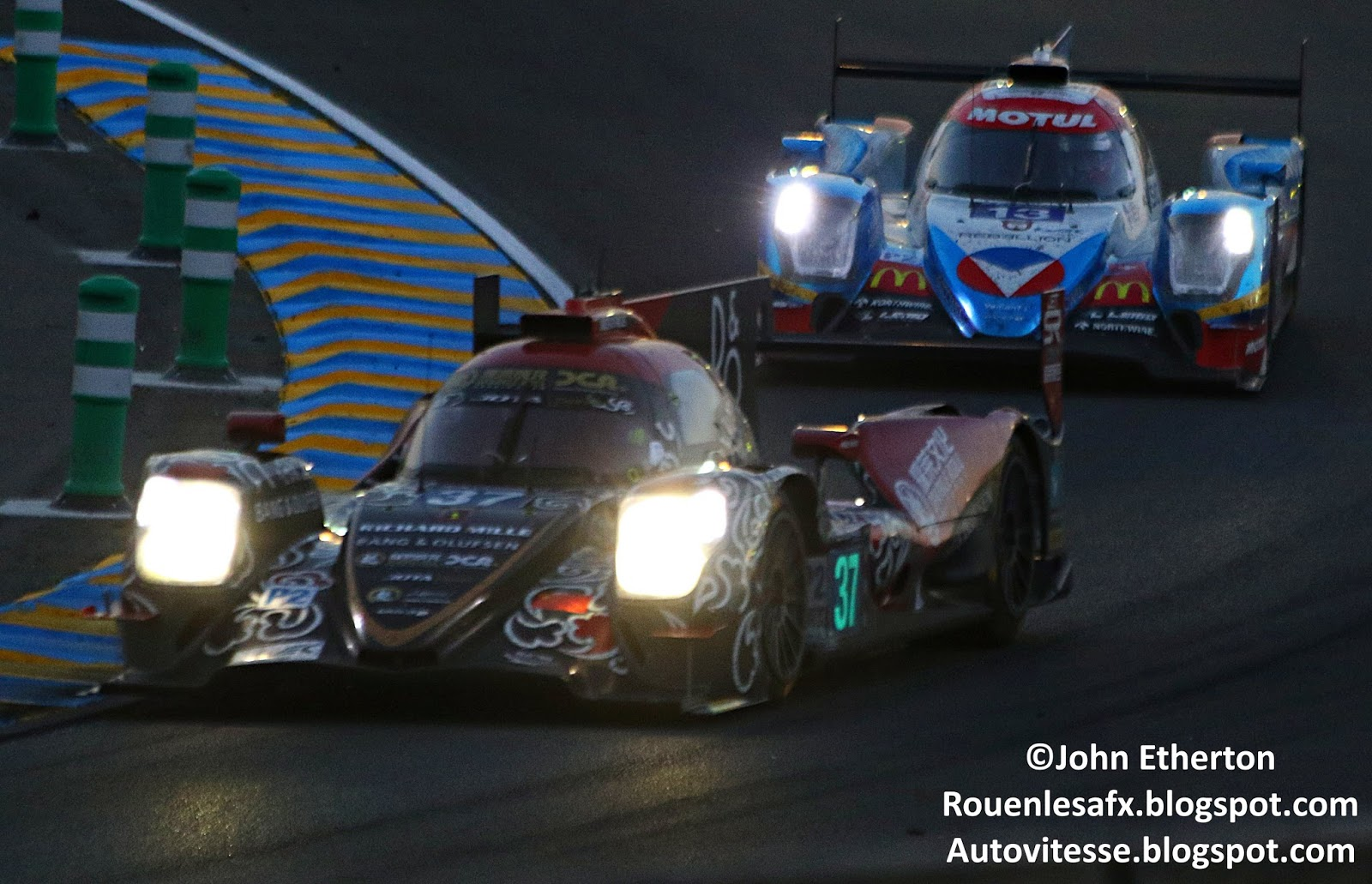 The second jackie chan car leads another lmp2 car through the esses on saturday night
