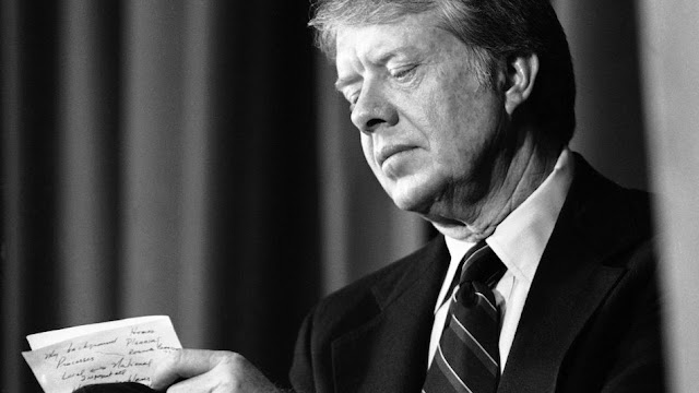Image Attribute: President Jimmy Carter makes notes prior to his address to the White House Conference on Balanced National Growth in Washington in Washington Thursday, Feb. 2, 1978. / Source: AP/BOB DAUGHERTY