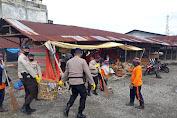 Brimob Polda Aceh Gelar Jumat Bersih di Pasar Simpang Empang.