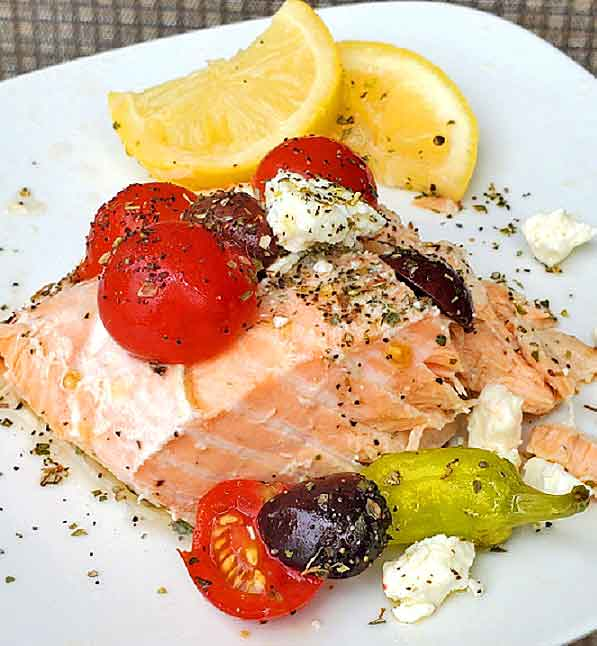salmon topped with Greek Salad