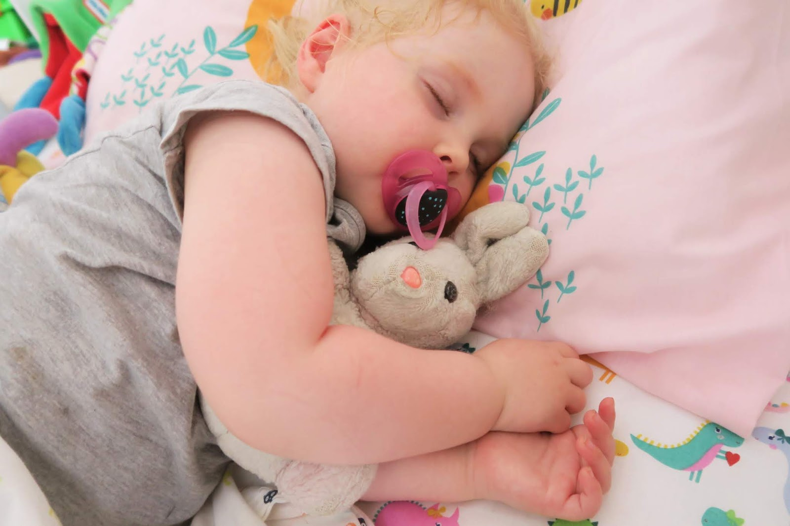 Elise asleep and cuddling my bunny toy from my childhood.