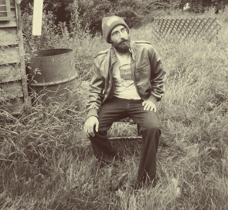 Dark wash Denim; Vintage shrunken graphic tee; Genuine light brown leather Members Only Jacket;  Green knit beanie.