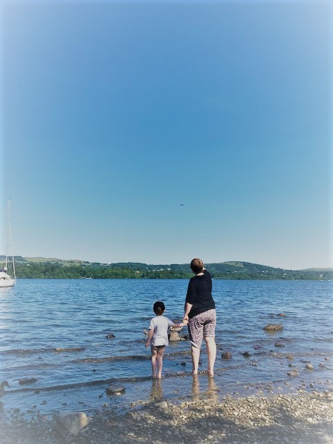 Mother and son paddling in a lake