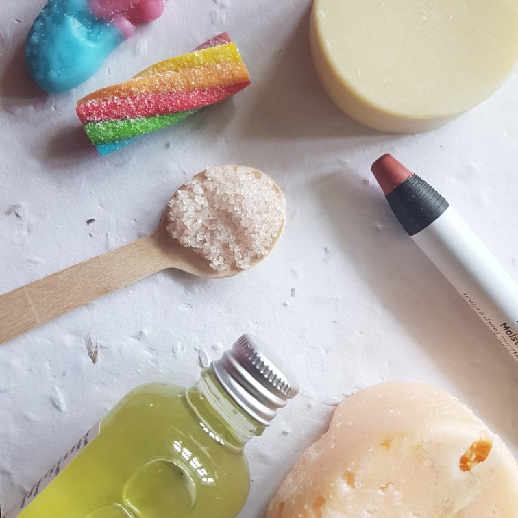 cruelty free vegan beauty and sweets on textured white paper