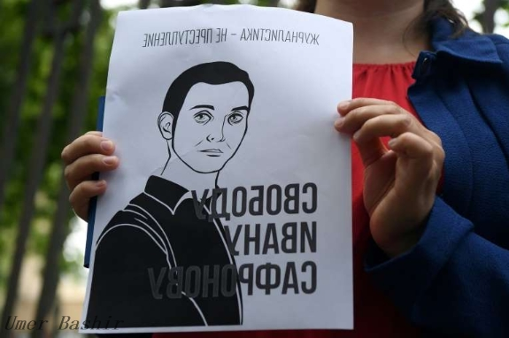 Supporters detained after the Russians accused the former reporter of treason
