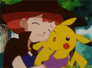 Lili mimando a Pikachu