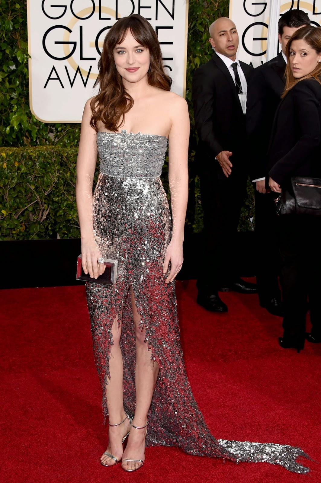 Dakota Johnson sizzles in a sparkling sequinned dress at the 2015 Golden Globes