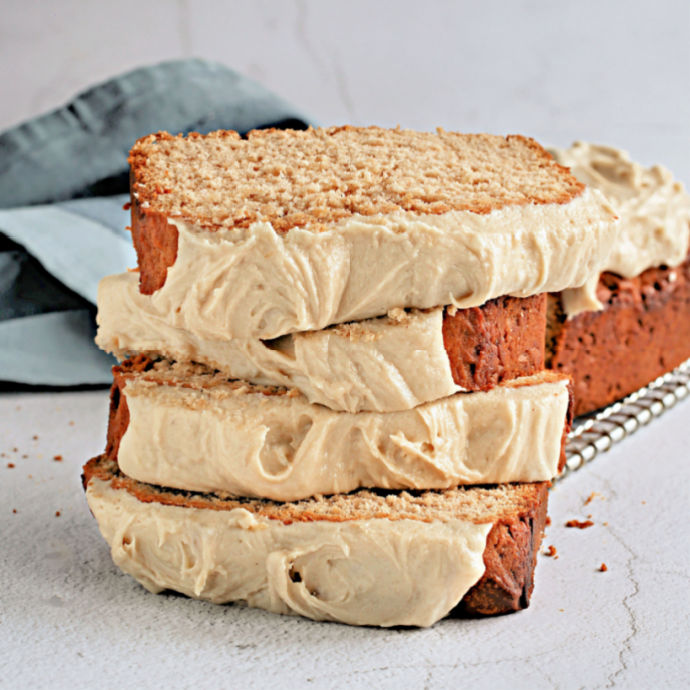 Recipe for a honey cake with cinnamon, ginger and nutmeg. Topped with a sweet tahini cream cheese frosting.