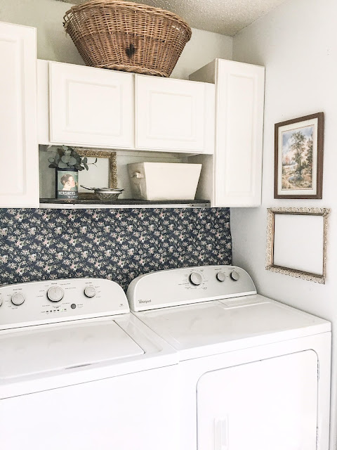 vintage navy blue and pink laundry room decor