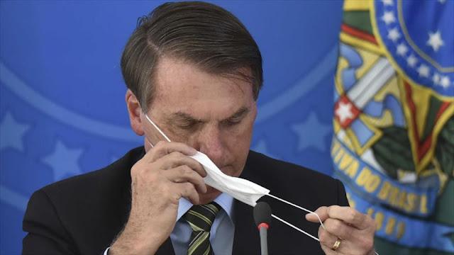 Bolsonaro sigue los pasos de Trump y amenaza con retirarse de OMS