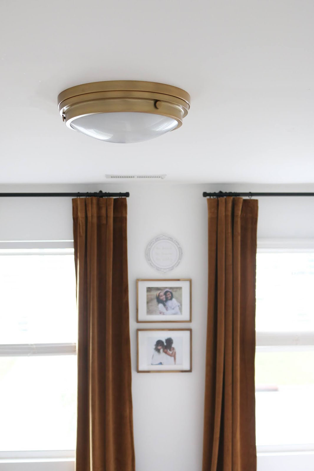 Brass Light Fixture and Luxe Velvet Curtains in a Shared Girls Room