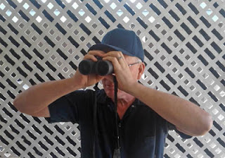 Image showing improper way to hold binoculars