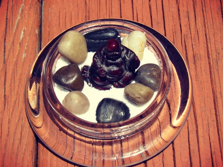 Miniature repurposed candle lid zen garden with sand, rocks, and a buddha statue + zen garden rake