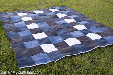 jean patchwork quilt on the grass.