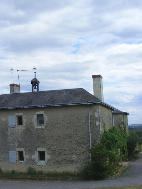 Bell on a winery roof.  Indre et Loire, France. Photographed by Susan Walter. Tour the Loire Valley with a classic car and a private guide.