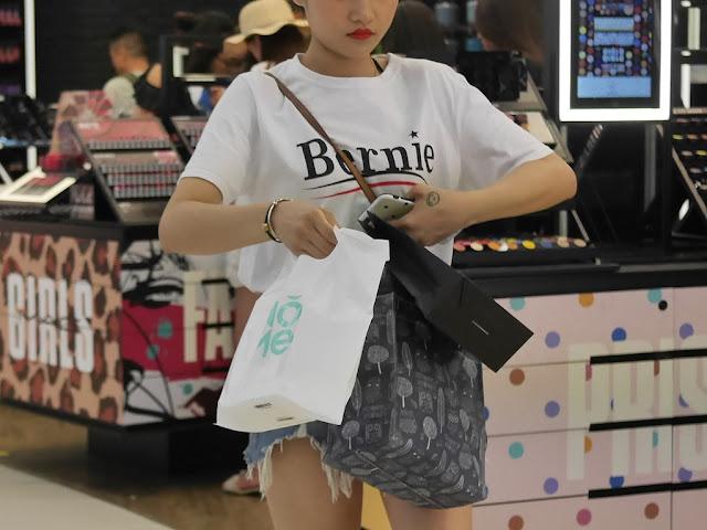 """young woman wearing a """"Bernie"""" shirt in Shenzhen, China"""