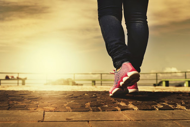 New Year goals - get fitter. Standing on a pier in running shoes