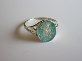Sterling silver ring containing ashes and a coloured setting