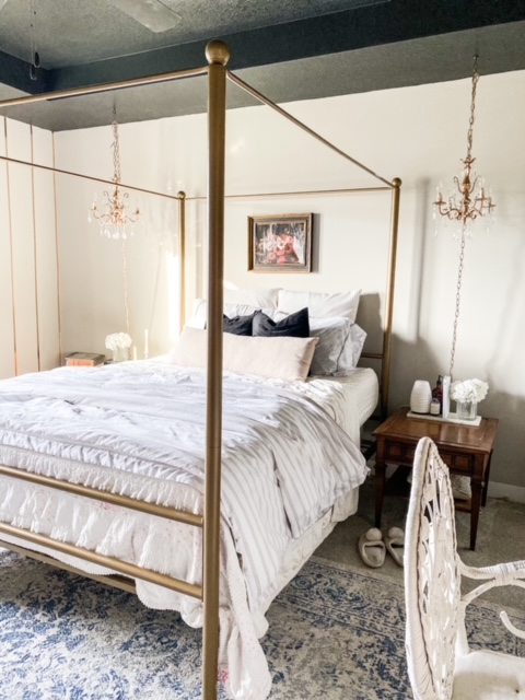 Gold four post bed white bedding