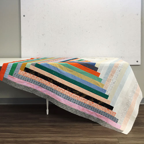 In Color Order: Giant Log Cabin Jelly Roll Quilt