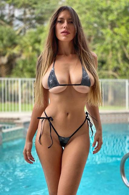 hot woman with big tits in sexy tiny bikini