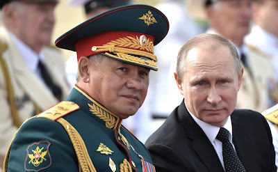 Vladimir Putin and Sergei Shoigu. The main Naval Parade in St. Petersburg.