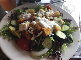 Eating a Buffalo Chicken Salad at the Salty Pelican on Amelia Island