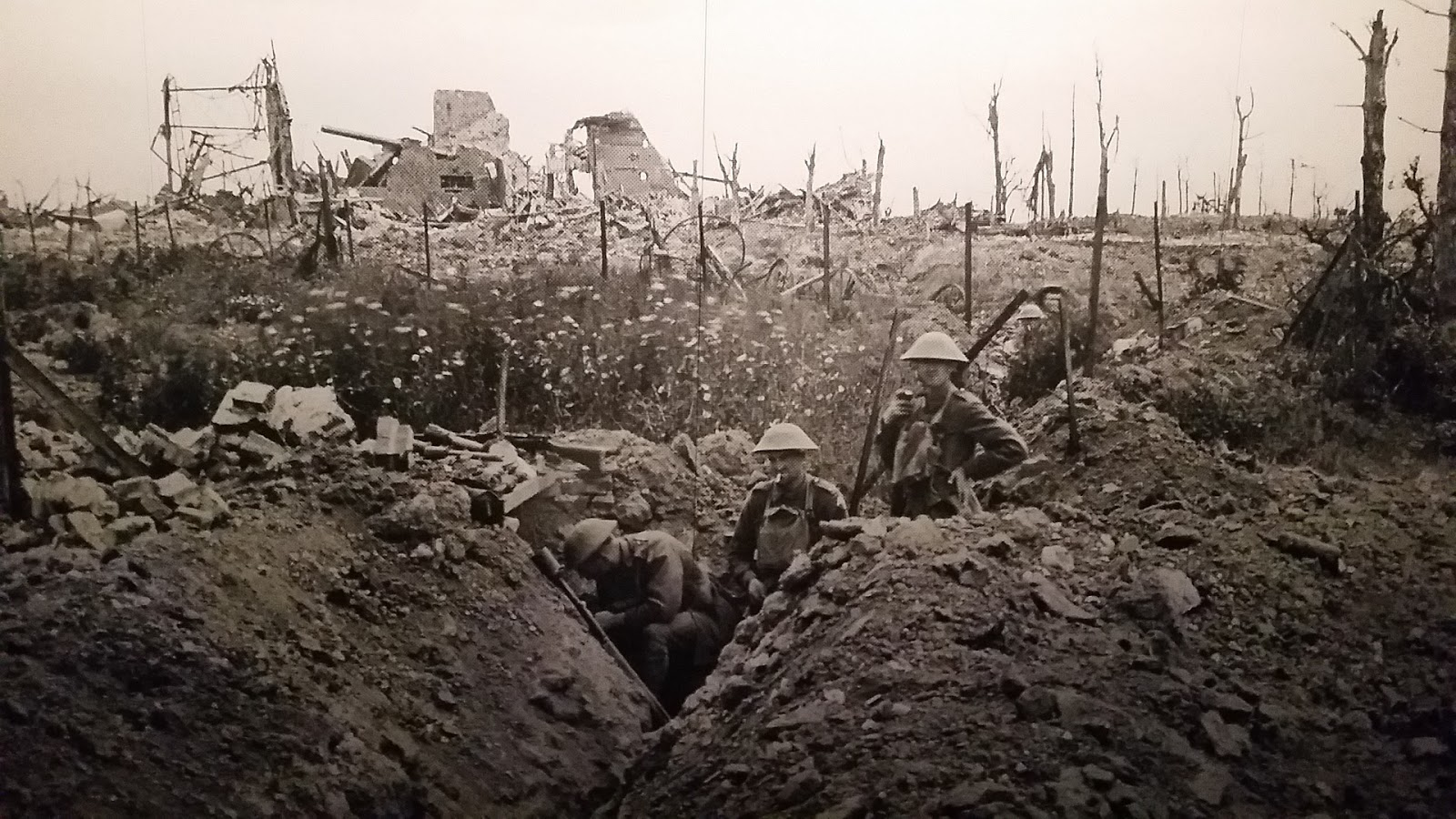 black and whtie photo of several soldiers standing in the trenches to illustrate a blog post about the movie 1917