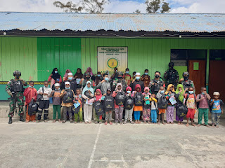 Menyambut HUT Batalyon ke-57, Satgas Yonif RK 751/VJS Menebar Senyum di Pegunungan Tengah Papua