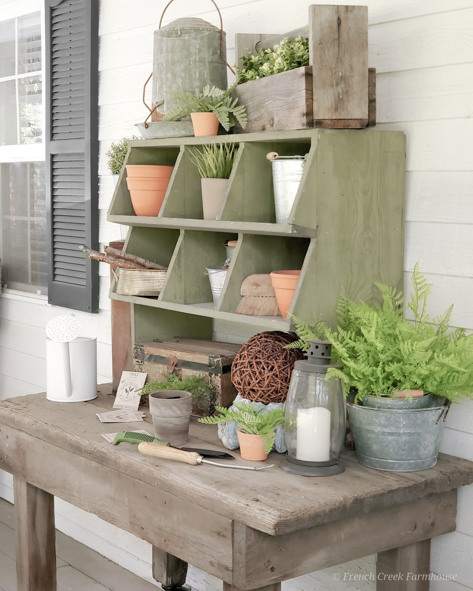 Our potting bench ready for spring on the front porch