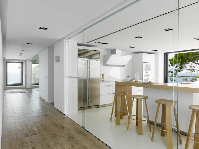 Modern kitchen with glass wall
