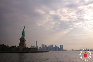 The Statue of Liberty, New York Harbor, sunrise, and the Manhattan syline